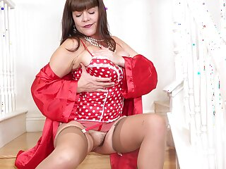 Dressed in red lingerie and beige nylon stockings busty Rebecca Love goes solo